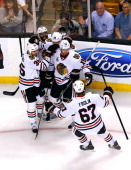 Marcus Kruger of the Chicago Blackhawks celebrates with teamates after a goal in the second period against the Boston Bruins in Game Four of the 2013...