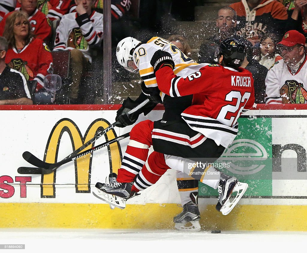 Marcus Kruger #22 of the Chicago Blackhawks collides with <a gi-track='captionPersonalityLinkClicked' href=/galleries/search?phrase=Lee+Stempniak&family=editorial&specificpeople=575240 ng-click='$event.stopPropagation()'>Lee Stempniak</a> #20 of the Boston Bruins at the United Center on April 3, 2016 in Chicago, Illinois.