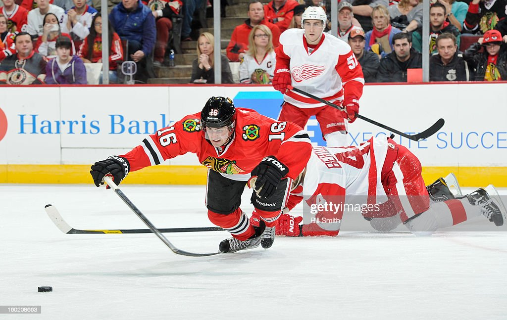 Marcus Kruger #16 of the Chicago Blackhawks flies toward the puck during the NHL game against the Detroit Red Wings on January 27, 2013 at the United Center in Chicago, Illinois.