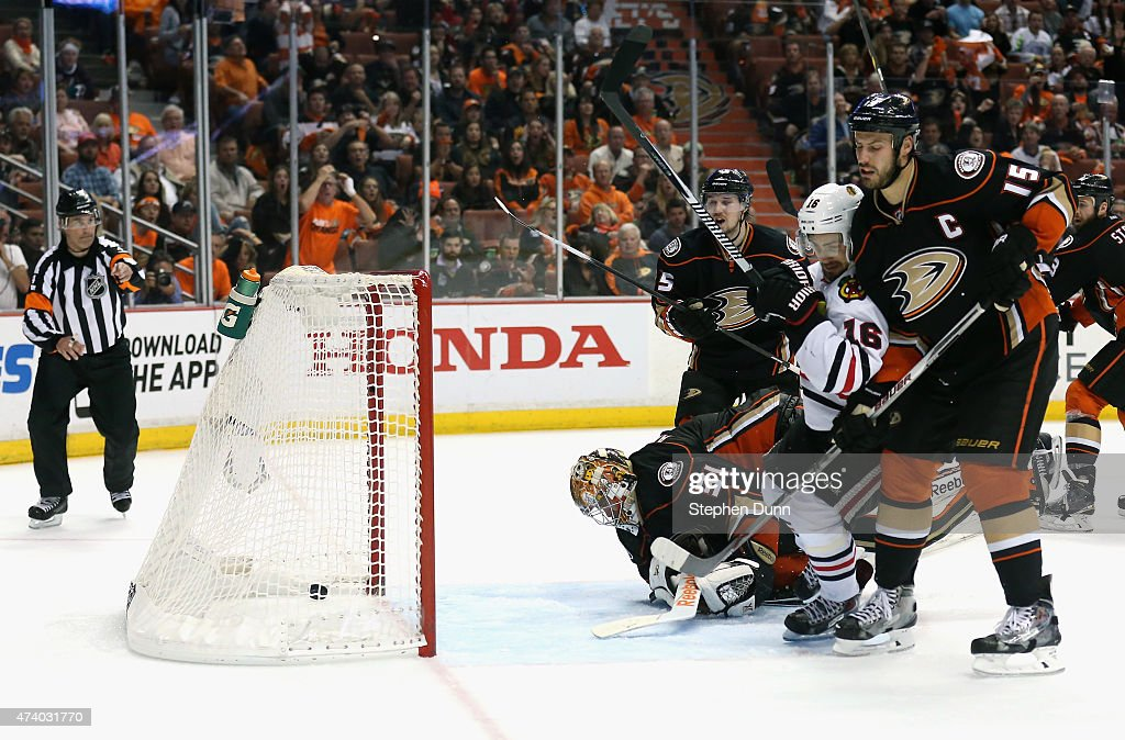 Marcus Kruger #16 of the Chicago Blackhawks gets the puck past goaltender <a gi-track='captionPersonalityLinkClicked' href=/galleries/search?phrase=Frederik+Andersen&family=editorial&specificpeople=6605243 ng-click='$event.stopPropagation()'>Frederik Andersen</a> #31 of the Anaheim Ducks to win the game 3-2 in triple overtime of Game Two of the Western Conference Finals during the 2015 NHL Stanley Cup Playoffs at Honda Center on May 19, 2015 in Anaheim, California.