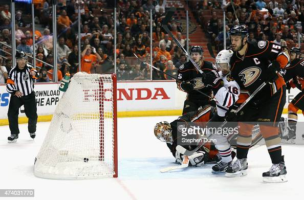 Marcus Kruger of the Chicago Blackhawks gets the puck past goaltender Frederik Andersen of the Anaheim Ducks to win the game 32 in triple overtime of...