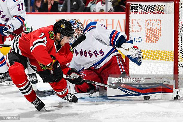 Marcus Kruger of the Chicago Blackhawks shoots the puck at goalie Antti Raanta of the New York Rangers in the third period at the United Center on...