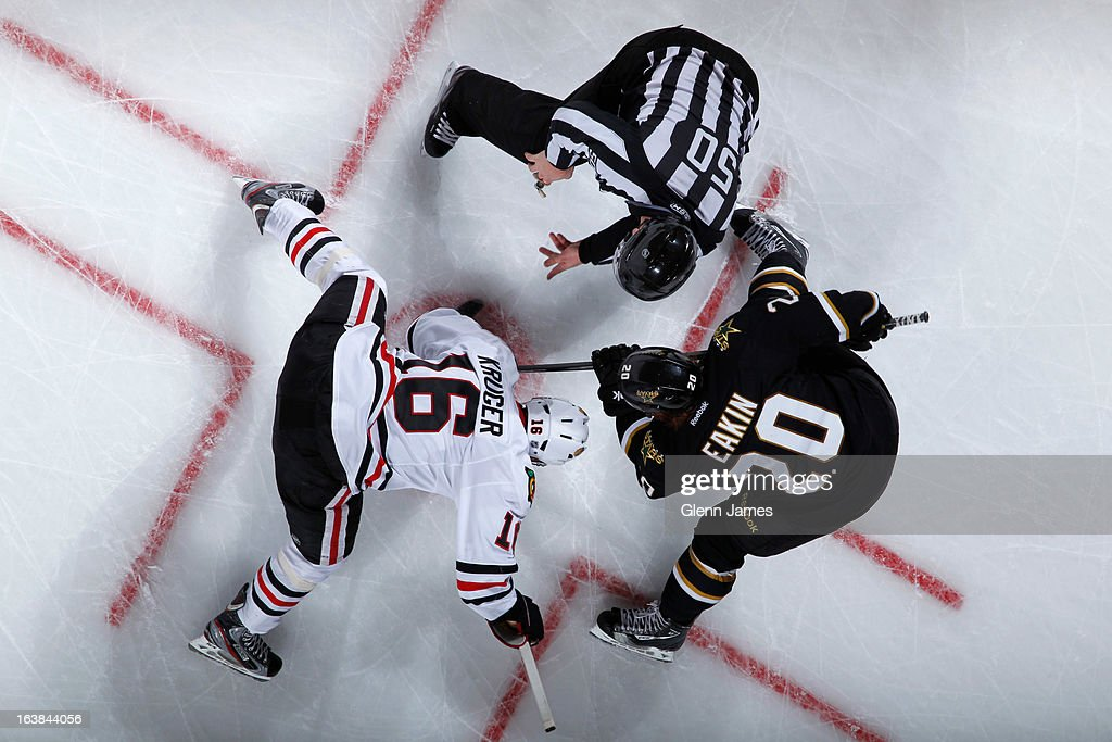 Marcus Kruger #16 of the Chicago Blackhawks tries to win a face off against <a gi-track='captionPersonalityLinkClicked' href=/galleries/search?phrase=Cody+Eakin&family=editorial&specificpeople=5662792 ng-click='$event.stopPropagation()'>Cody Eakin</a> #20 of the Dallas Stars at the American Airlines Center on March 16, 2013 in Dallas, Texas.