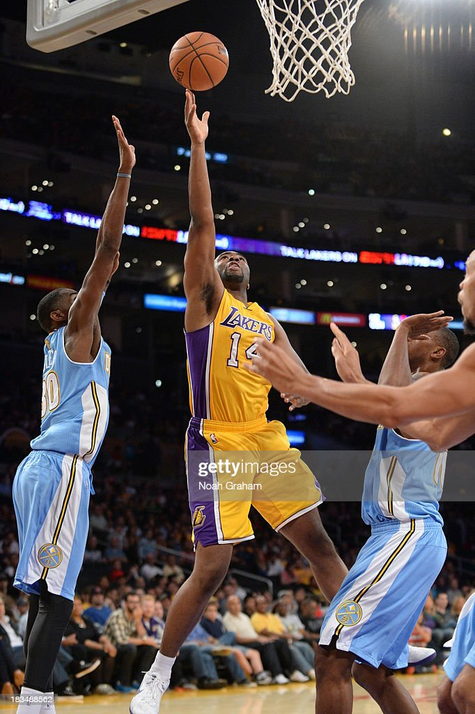 <a gi-track='captionPersonalityLinkClicked' href=/galleries/search?phrase=Marcus+Landry&family=editorial&specificpeople=2095929 ng-click='$event.stopPropagation()'>Marcus Landry</a> #14 of the Los Angeles Lakers shoots during a game against the Denver Nuggets at STAPLES Center on October 10, 2013 at in Los Angeles, California.