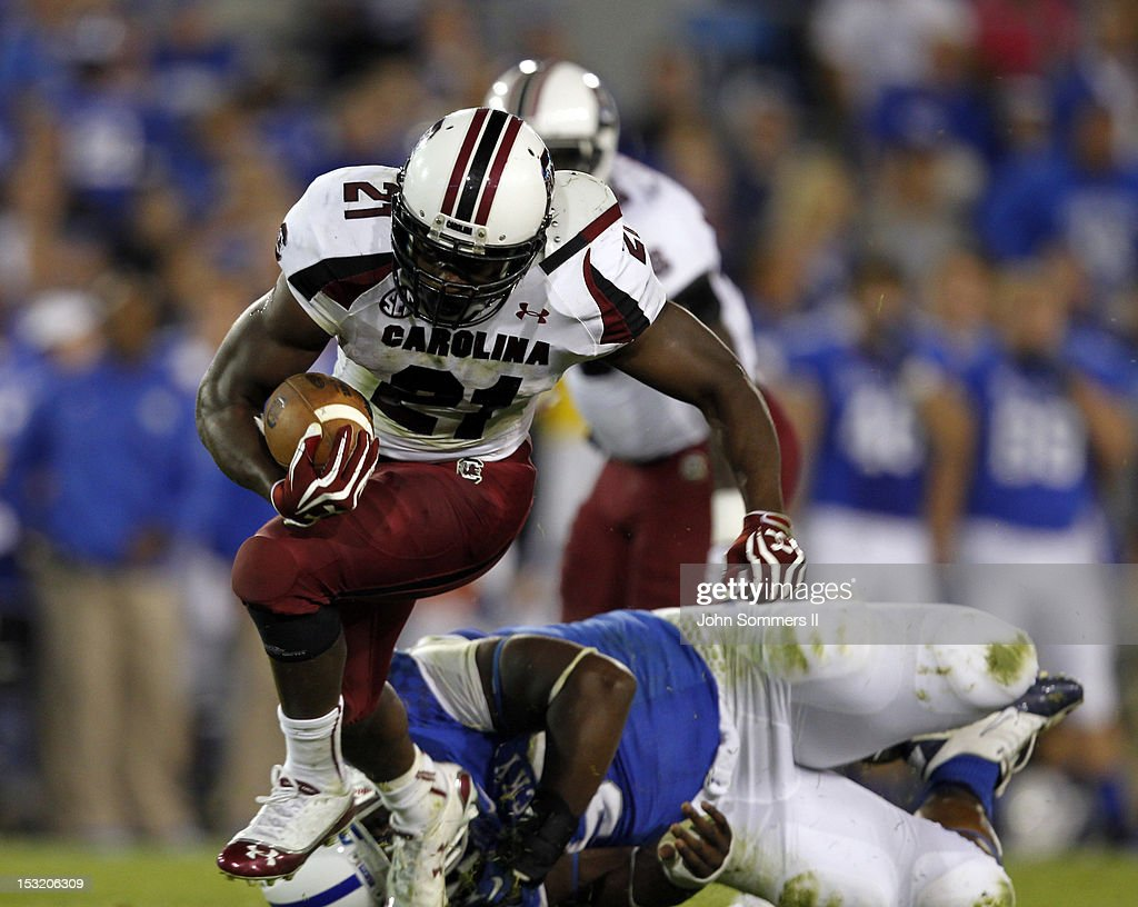 <a gi-track='captionPersonalityLinkClicked' href=/galleries/search?phrase=Marcus+Lattimore&family=editorial&specificpeople=7183280 ng-click='$event.stopPropagation()'>Marcus Lattimore</a> #21 of the South Carolina Gamecocks breaks free from the Kentucky Wildcats during at Commonwealth Stadium on September 29, 2012 in Lexington, Kentucky.