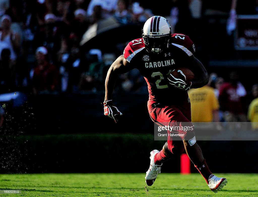 <a gi-track='captionPersonalityLinkClicked' href=/galleries/search?phrase=Marcus+Lattimore&family=editorial&specificpeople=7183280 ng-click='$event.stopPropagation()'>Marcus Lattimore</a> #21 of the South Carolina Gamecocks runs against the Missouri Tigers during play at Williams-Brice Stadium on September 22, 2012 in Columbia, South Carolina.