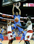Marcus Lee of the Kentucky Wilcats dunks the ball during the game against the Louisville Cardinals at KFC YUM Center on December 27 2014 in...