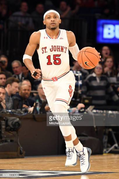 Marcus LoVett of the St John's Red Storm dribbles up court during the Big East Basketball Tournament First Round game against the Georgetown Hoyas at...