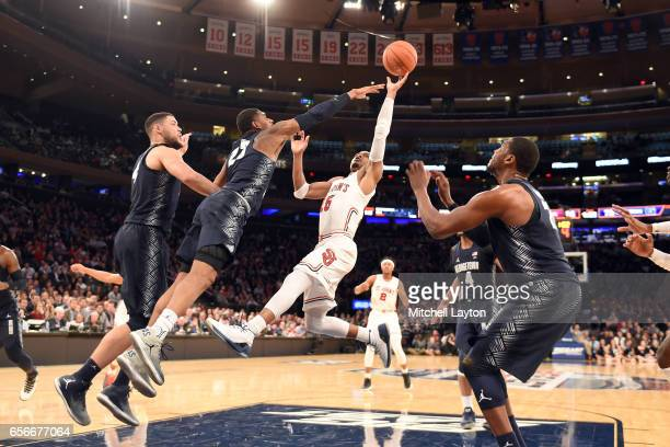 Marcus LoVett of the St John's Red Storm takes a shot during the Big East Basketball Tournament First Round game against the Georgetown Hoyas at...