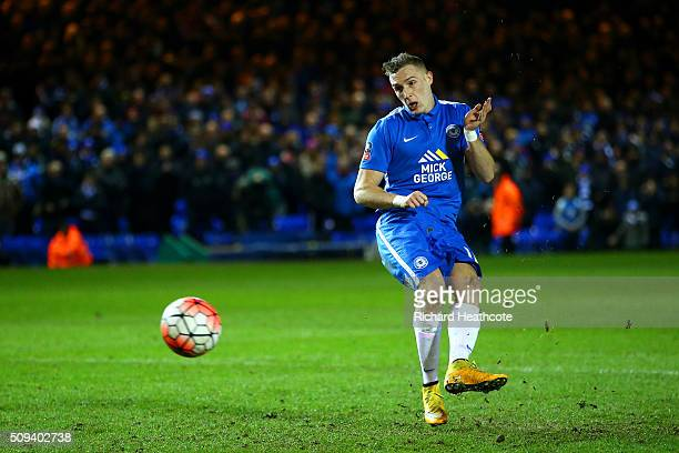 Marcus Maddison of Peterborough scores his penalty during the penalty shootout in the Emirates FA Cup fourth round replay match between Peterborough...
