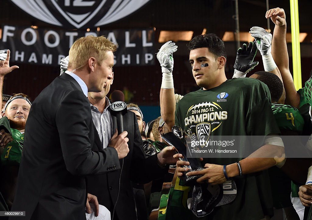 <a gi-track='captionPersonalityLinkClicked' href=/galleries/search?phrase=Marcus+Mariota&family=editorial&specificpeople=8572256 ng-click='$event.stopPropagation()'>Marcus Mariota</a> #8 of the Oregon Ducks, celebrates their victory against the Arizona Wildcats at the PAC-12 Championships at Levi's Stadium on December 5, 2014 in Santa Clara, California.