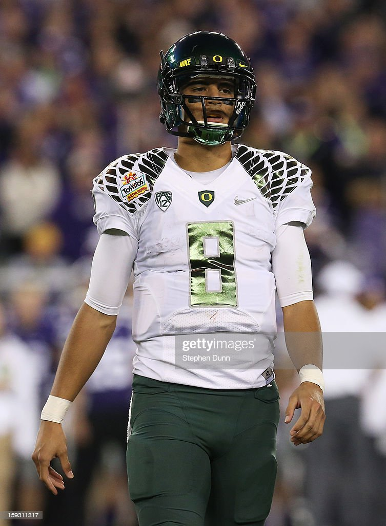 Marcus Mariota #8 of the Oregon Ducks looks on during the Tostitos Fiesta Bowl against the Kansas State Wildcats at University of Phoenix Stadium on January 3, 2013 in Glendale, Arizona.