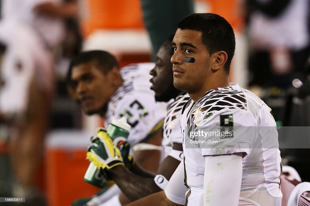 Marcus Mariota #8 of the Oregon Ducks looks on from the bench during the Tostitos Fiesta Bowl against the Kansas State Wildcats at University of Phoenix Stadium on January 3, 2013 in Glendale, Arizona.
