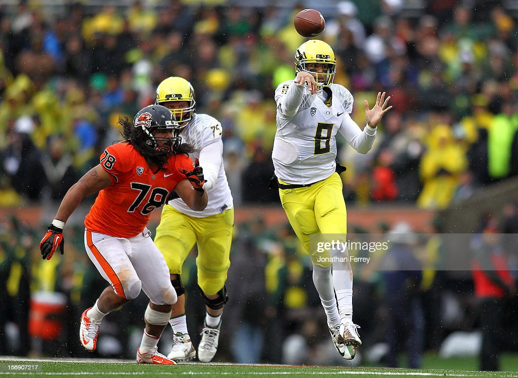 Marcus Mariota #8 of the Oregon Ducks throws a pass against the Oregon State Beavers during the 116th Civil War on November 24, 2012 at the Reser Stadium in Corvallis, Oregon.