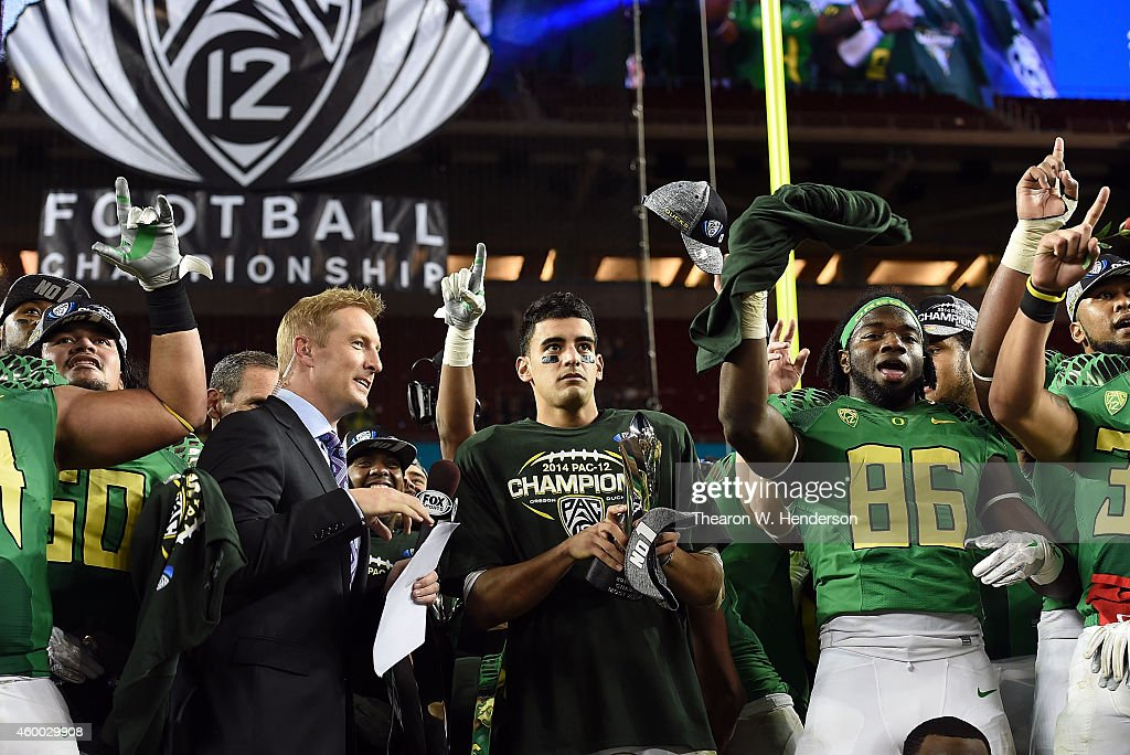 <a gi-track='captionPersonalityLinkClicked' href=/galleries/search?phrase=Marcus+Mariota&family=editorial&specificpeople=8572256 ng-click='$event.stopPropagation()'>Marcus Mariota</a> #8 of the Oregon Ducks, Torrodney Prevot #86 of the Oregon Ducks celebrate their victory against the Arizona Wildcats at the PAC-12 Championships at Levi's Stadium on December 5, 2014 in Santa Clara, California.