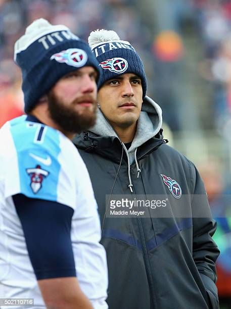 Marcus Mariota of the Tennessee Titans and Zach Mettenberger look on from the sideline during the game against the New England Patriots at Gillette...
