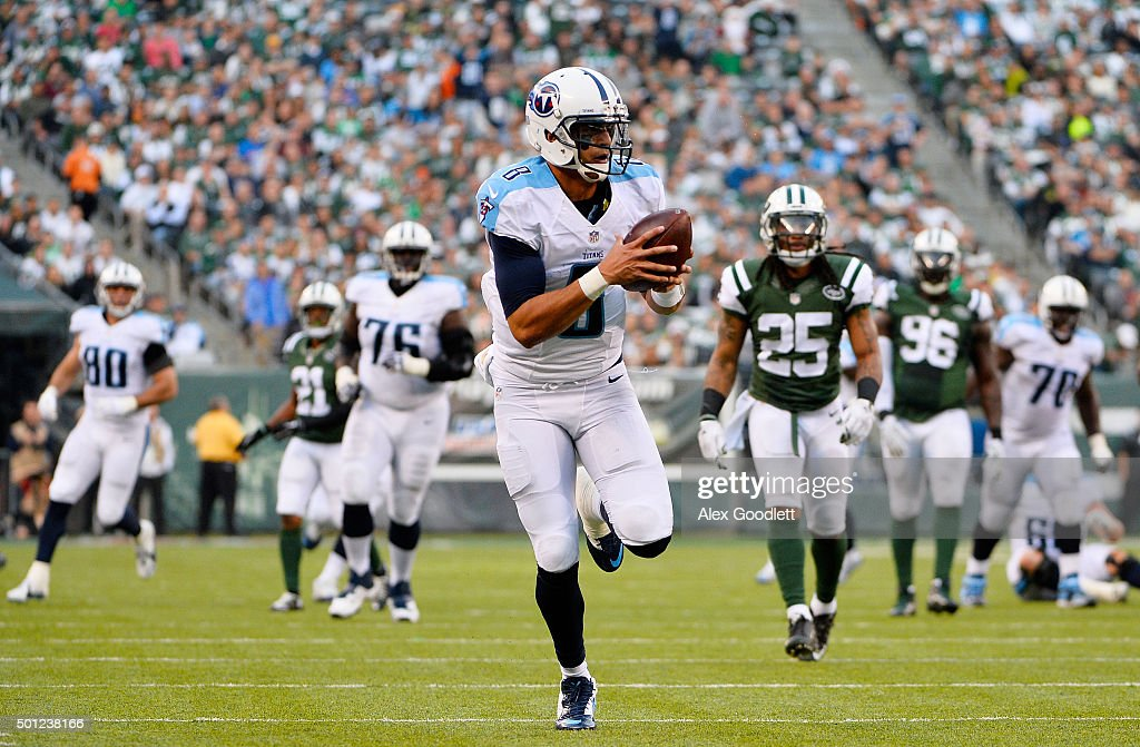 <a gi-track='captionPersonalityLinkClicked' href=/galleries/search?phrase=Marcus+Mariota&family=editorial&specificpeople=8572256 ng-click='$event.stopPropagation()'>Marcus Mariota</a> #8 of the Tennessee Titans completes a pass from Antonio Andrews #26 for a touchdown in the third quarter against the New York Jets during their game at MetLife Stadium on December 13, 2015 in East Rutherford, New Jersey.