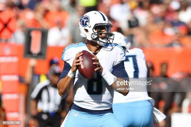 Marcus Mariota of the Tennessee Titans drops back for a pass in the first quarter against the Cleveland Browns at FirstEnergy Stadium on October 22...