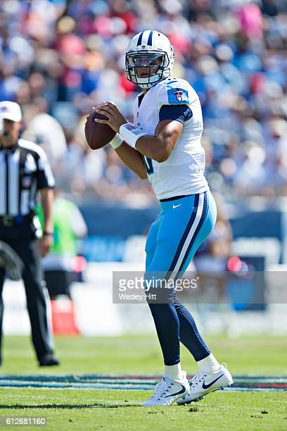 Marcus Mariota of the Tennessee Titans drops back to pass during a game against the Oakland Raiders at Nissan Stadium on September 25 2016 in...