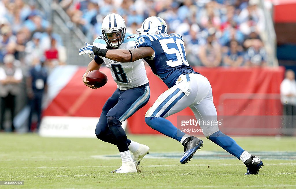 <a gi-track='captionPersonalityLinkClicked' href=/galleries/search?phrase=Marcus+Mariota&family=editorial&specificpeople=8572256 ng-click='$event.stopPropagation()'>Marcus Mariota</a> #8 of the Tennessee Titans is sacked by <a gi-track='captionPersonalityLinkClicked' href=/galleries/search?phrase=Jerrell+Freeman&family=editorial&specificpeople=5441871 ng-click='$event.stopPropagation()'>Jerrell Freeman</a> #50 of the Indianapolis Colts during the game at LP Field on September 27, 2015 in Nashville, Tennessee.