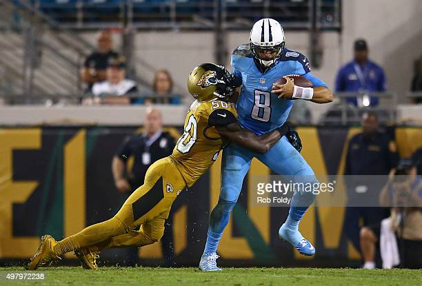Marcus Mariota of the Tennessee Titans is sacked by Telvin Smith of the Jacksonville Jaguars during the second half of the game at EverBank Field on...