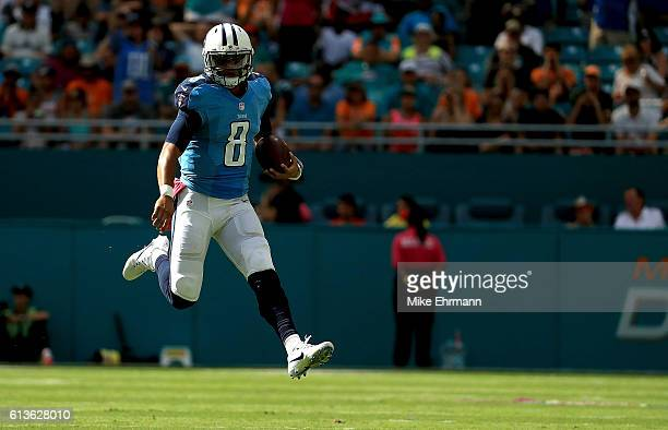 Marcus Mariota of the Tennessee Titans rushes during a game against the Miami Dolphins on October 9 2016 in Miami Gardens Florida