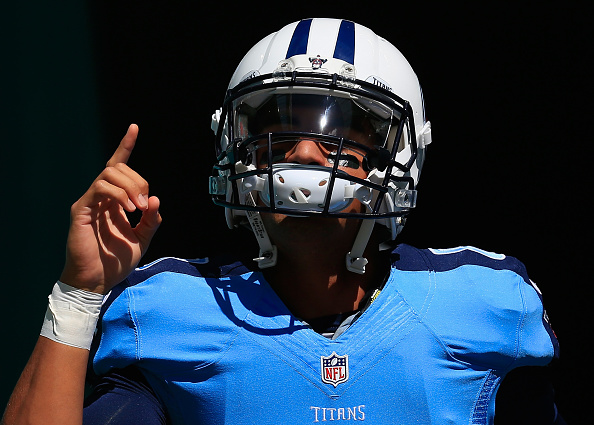Marcus Mariota of the Tennessee Titans walks on to the field prior to a game against the Miami Dolphins at Hard Rock Stadium on October 9 2016 in...