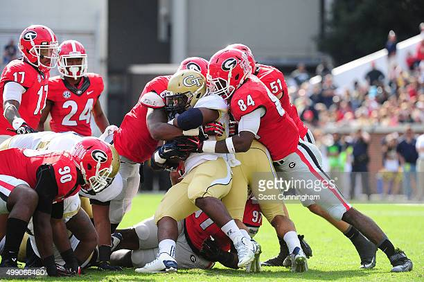 Marcus Marshall of the Georgia Tech Yellow Jackets is tackled by Leonard Floyd of the Georgia Bulldogs at Bobby Dodd Stadium on November 28 2015 in...