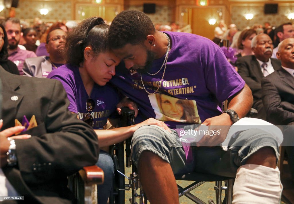 Marcus Martin (R) hugs his fiance Marissa Blair during a memorial for Heather Heyer at the Paramount Theater on August 16, 2017 in Charlottesville, Va. Heyer was killed Saturday, when a car rammed into a crowd of people protesting a white nationalist rally.