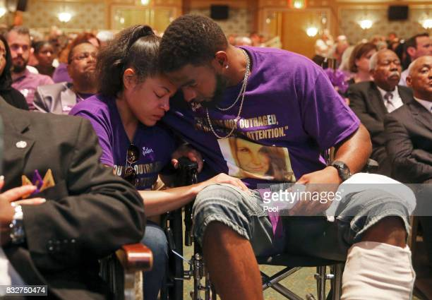 Marcus Martin hugs his fiance Marissa Blair during a memorial for Heather Heyer at the Paramount Theater on August 16 2017 in Charlottesville Va...