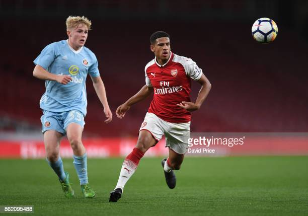 Marcus McGuane of Arsenal takes on Adam Bale of Sunderland during the Premier League 2 match between Arsenal and Sunderland at Emirates Stadium on...