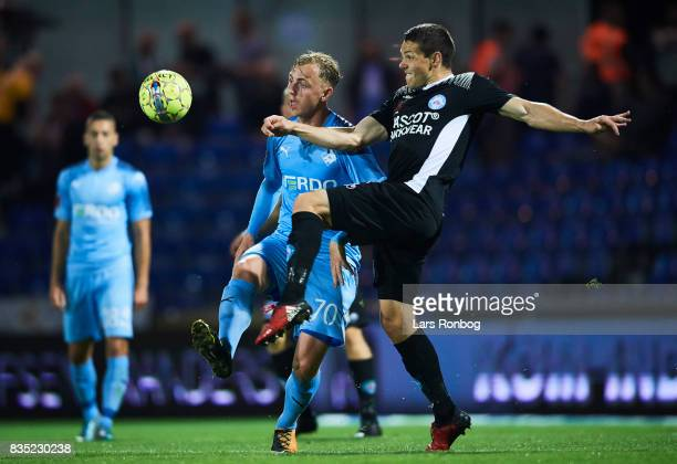 Marcus Molvadgaard of Randers FC and Mikkel Cramer of Silkeborg IF compete for the ball during the Danish Alka Superliga match between Randers FC and...