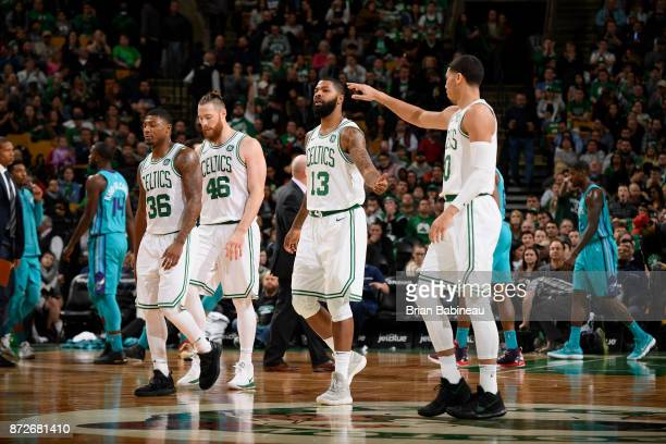 Marcus Morris and Jayson Tatum of the Boston Celtics high five during the game against the Charlotte Hornets on November 10 2017 at the TD Garden in...