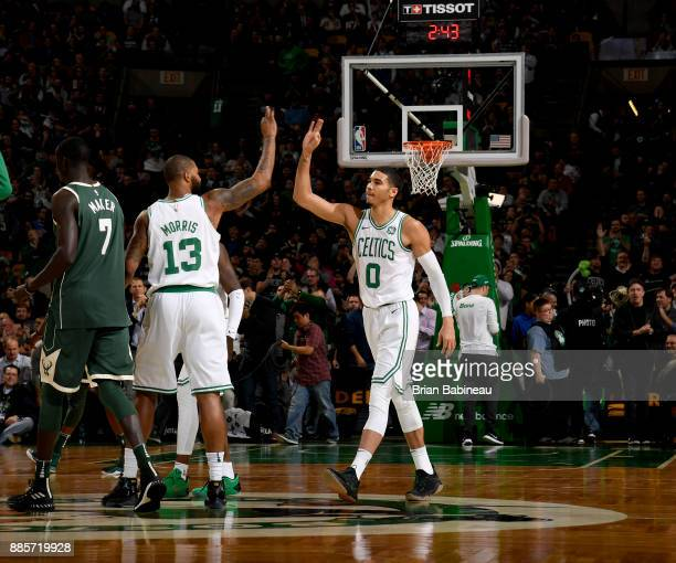 Marcus Morris and Jayson Tatum of the Boston Celtics high five during the game against the Milwaukee Bucks on December 4 2017 at the TD Garden in...