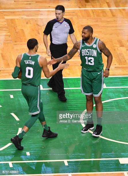 Marcus Morris and Jayson Tatum of the Boston Celtics share a moment during the game against the Golden State Warriors on November 16 2017 at the TD...
