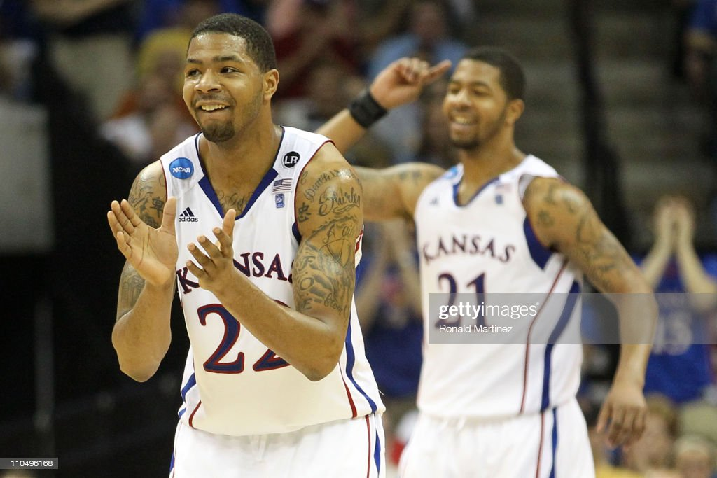 Marcus Morris and Markieff Morris of the Kansas Jayhawks celebrate after a play against the Illinois Fighting Illini during the third round of the...