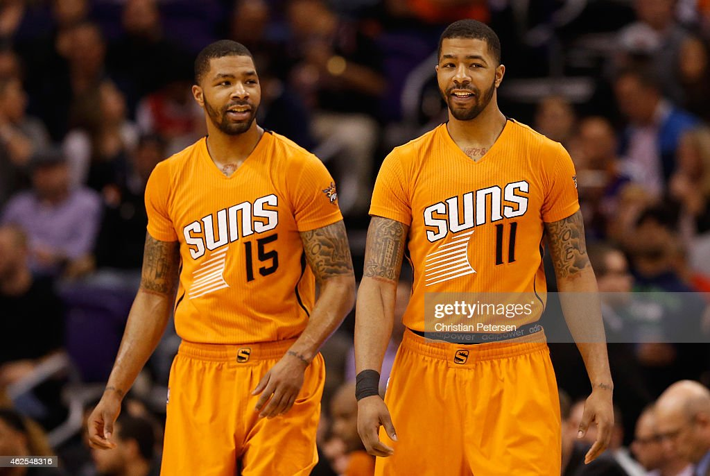 Marcus Morris and Markieff Morris of the Phoenix Suns check in during the second half of the NBA game against the Chicago Bulls at US Airways Center...