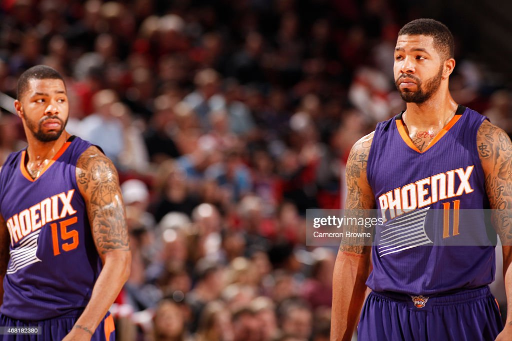 Marcus Morris and Markieff Morris of the Phoenix Suns during the game against the Portland Trail Blazers on March 30 2015 at Moda Center in Portland...