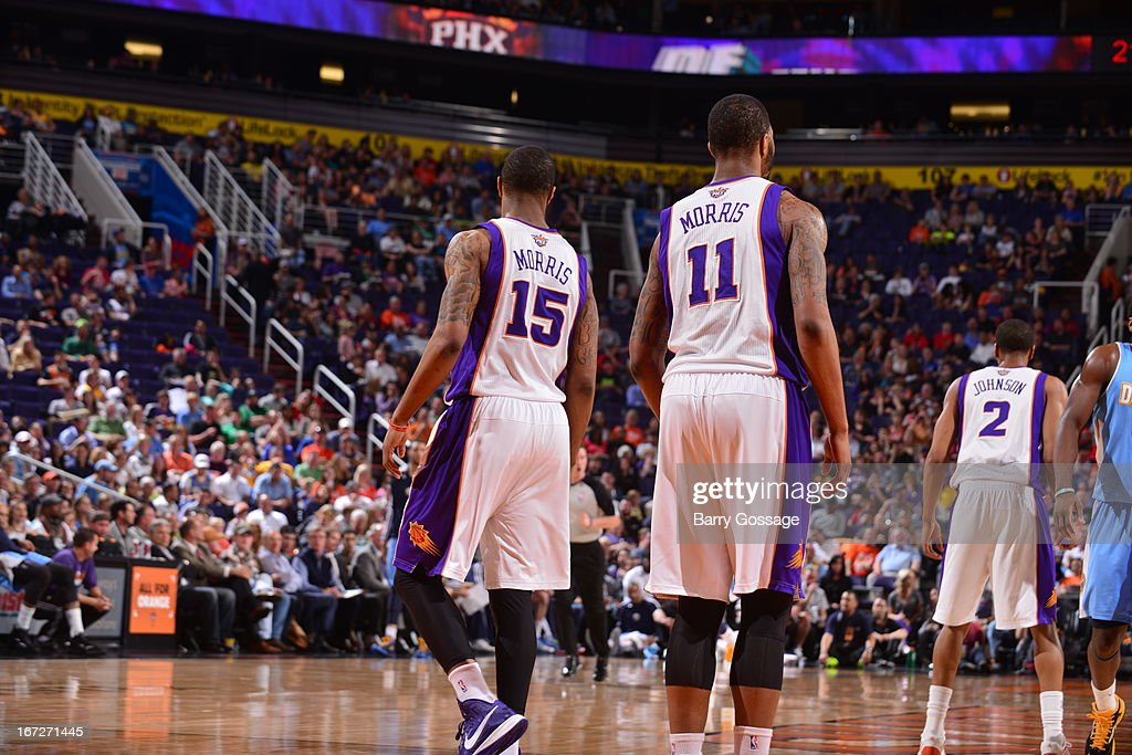 Marcus Morris #15 and <a gi-track='captionPersonalityLinkClicked' href=/galleries/search?phrase=Markieff+Morris&family=editorial&specificpeople=5293881 ng-click='$event.stopPropagation()'>Markieff Morris</a> #11 of the Phoenix Suns stand on the court during the game against the Denver Nuggets on March 11, 2013 at U.S. Airways Center in Phoenix, Arizona.