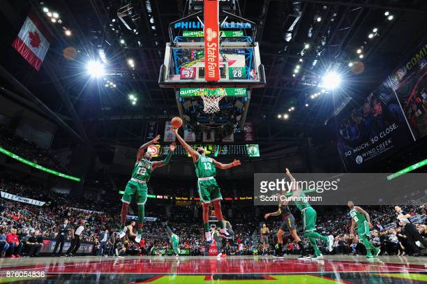 Marcus Morris and Terry Rozier of the Boston Celtics jump for the rebound against the Atlanta Hawks on November 18 2017 at Philips Arena in Atlanta...