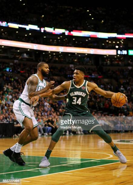 Marcus Morris of the Boston Celtics defends Giannis Antetokounmpo of the Milwaukee Bucks during the second quarter at TD Garden on December 4 2017 in...