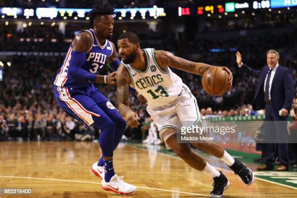 Marcus Morris of the Boston Celtics drives against Robert Covington of the Philadelphia 76ers during the first quarter at TD Garden on November 30...