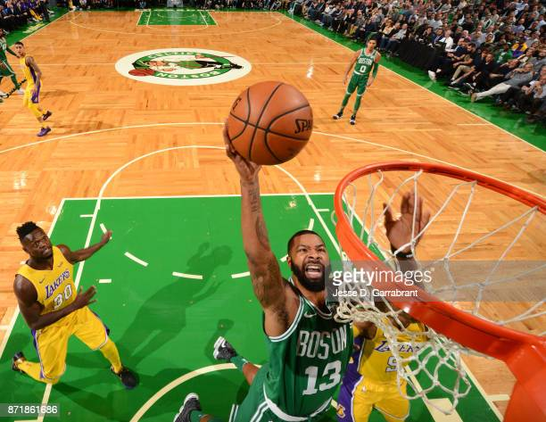 Marcus Morris of the Boston Celtics dunks the ball during the game against the Los Angeles Lakers on November 8 2017 at the TD Garden in Boston...