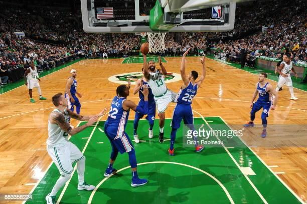 Marcus Morris of the Boston Celtics goes to the basket against the Philadelphia 76ers on November 30 2017 at the TD Garden in Boston Massachusetts...