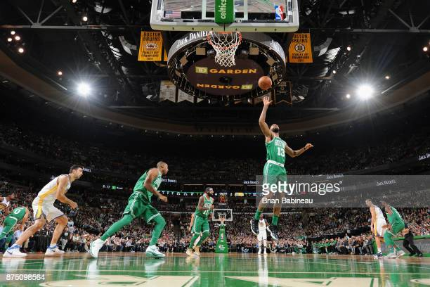 Marcus Morris of the Boston Celtics grabs the rebound against the Golden State Warriors on November 16 2017 at the TD Garden in Boston Massachusetts...