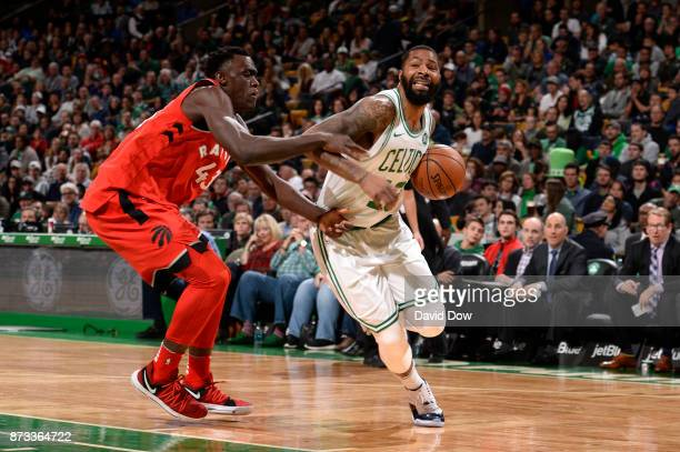 Marcus Morris of the Boston Celtics handles the ball against Pascal Siakam of the Toronto Raptors on November 12 2017 at the TD Garden in Boston...
