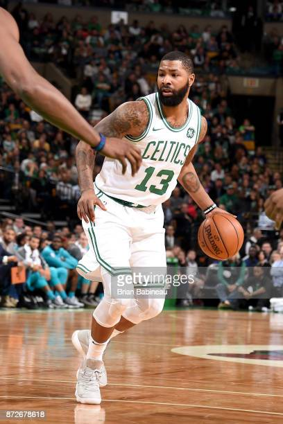 Marcus Morris of the Boston Celtics handles the ball against the Charlotte Hornets on November 10 2017 at the TD Garden in Boston Massachusetts NOTE...