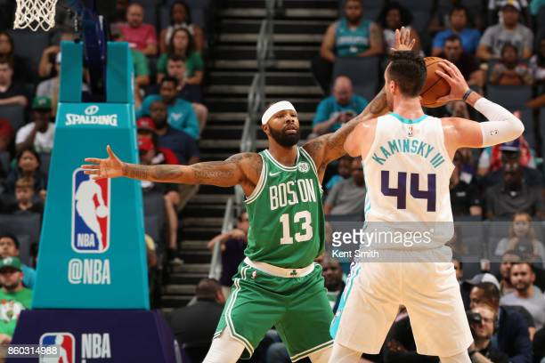 Marcus Morris of the Boston Celtics plays defense against the Charlotte Hornets on October 11 2017 at Spectrum Center in Charlotte North Carolina...