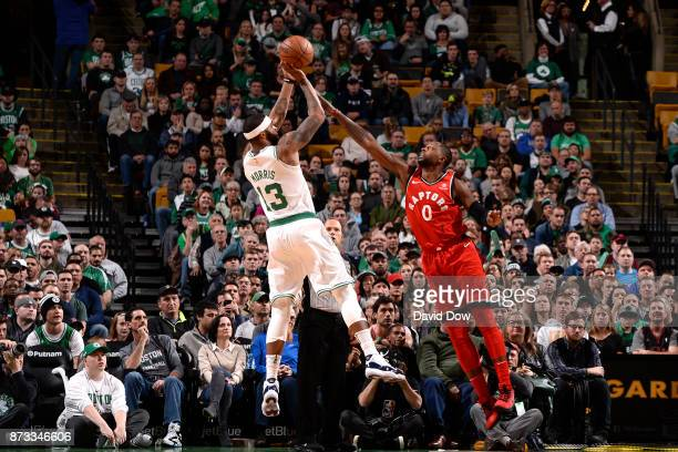 Marcus Morris of the Boston Celtics shoots the ball against CJ Miles of the Toronto Raptors on November 12 2017 at the TD Garden in Boston...
