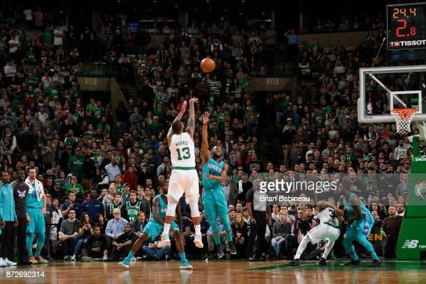 Marcus Morris of the Boston Celtics shoots the ball against the Charlotte Hornets on November 10 2017 at the TD Garden in Boston Massachusetts NOTE...